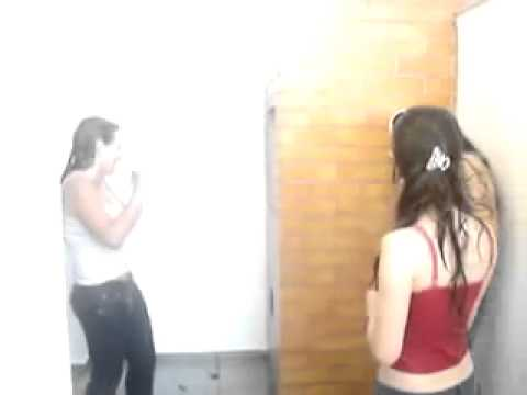 Three girls getting her jeans wet